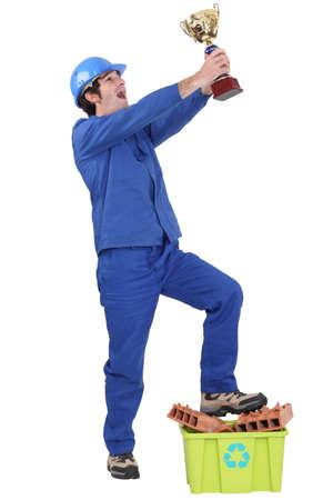 Elated tradesman celebrating his win photo