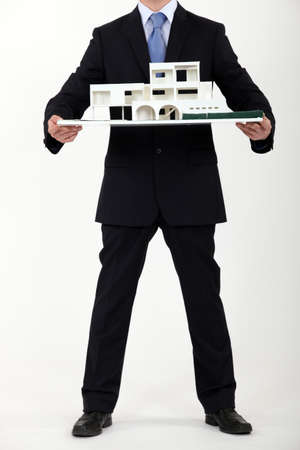 Architect presenting model housing photo