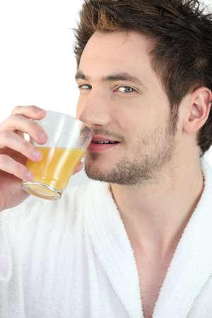 appropriate: Man drinking orange juice Stock Photo