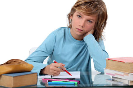 private schools: teenage boy doing homework Stock Photo