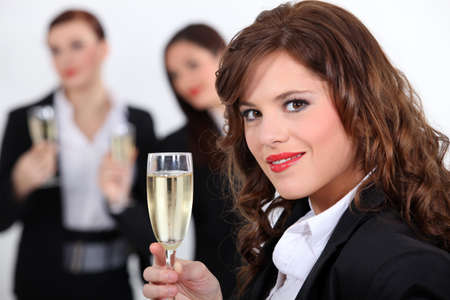 three businesswomen drinking champagne photo