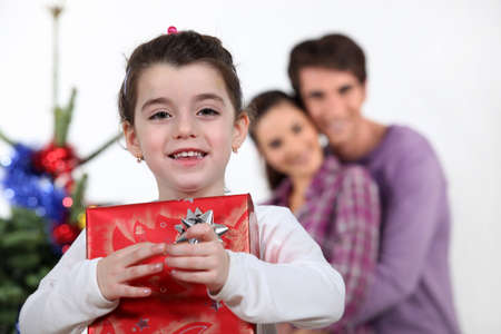 Young girl with a Christmas present photo