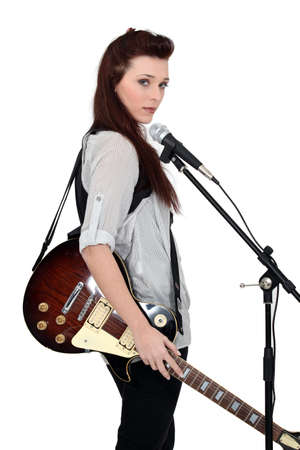 Woman beat guitar: Woman with guitar and microphone