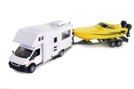 speed boat: Camping vehicle pulling speed boat on trailer Stock Photo