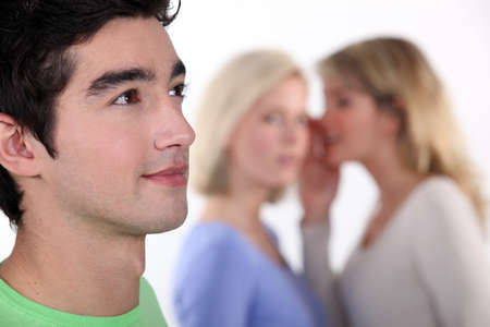 women sharing secrets about young man Stock Photo - 15449199