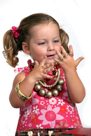 An adorable little girl with plenty of jewelry. photo