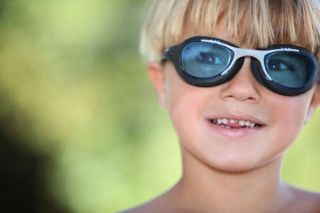 Young boy wearing swimming goggles photo