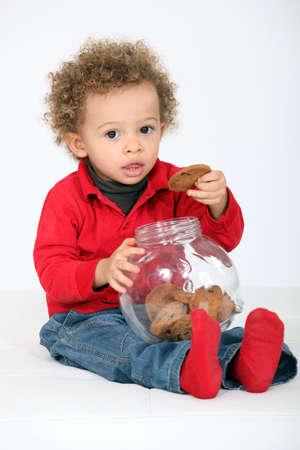 allergen: portrait of infant eating cookies Stock Photo