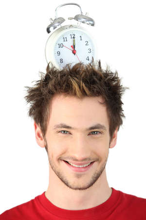 Man with alarm clock on his head Stock Photo - 15449231