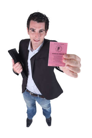 man showing a driving license photo