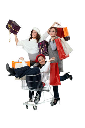 three girlfriends shopping at the mall Stock Photo - 15449316