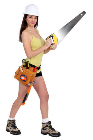 safety boots: Woman with a handsaw