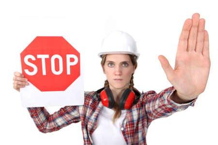 intercept: Woman holding stop sign Stock Photo