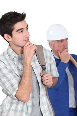 A manual worker and his trainee thinking. Stock Photo - 15449171