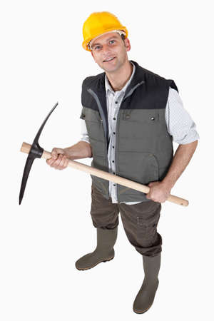 muscled: bricklayer holding pickaxe