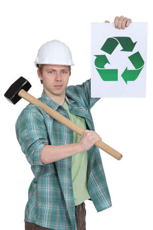 rubble: Construction worker with recycling poster Stock Photo