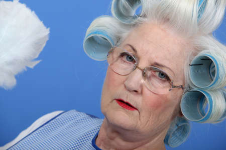 curlers: Granny with her hair in rollers Stock Photo