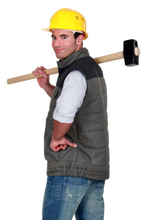 grabbing at the back: Craftsman with shoulder harness Stock Photo