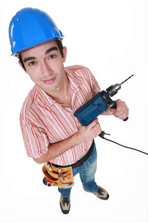 electric drill: Young man with a power drill