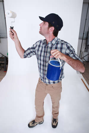 painter and decorator: Decorator with a paint roller Stock Photo