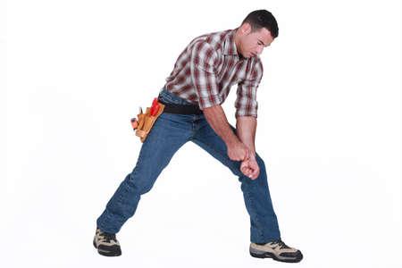 straining: craftsman making pulling gesture