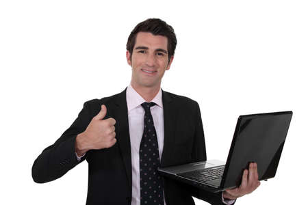 A businessman giving the thumb up. Stock Photo - 15449333