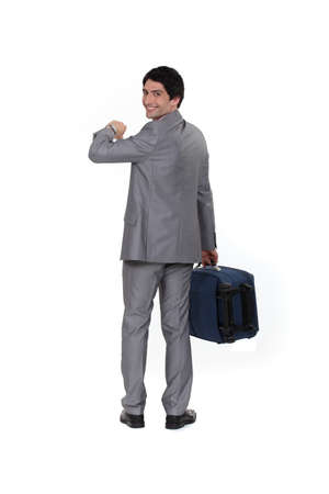 arrive: Businessman looking at the time Stock Photo
