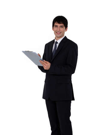 Businessman writing on his clipboard Stock Photo - 15449350