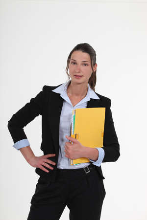 pantsuit: Businesswoman with a folder Stock Photo