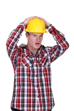 Shocked construction worker photo