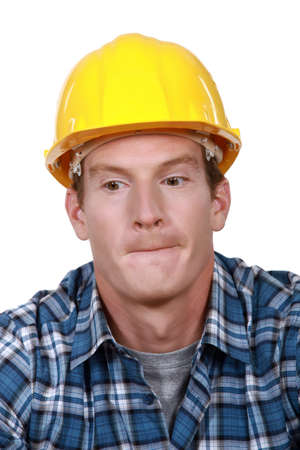 A portrait of a construction worker biting his lips Stock Photo - 15449567