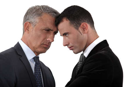 people arguing: Boss and employee locking horns Stock Photo