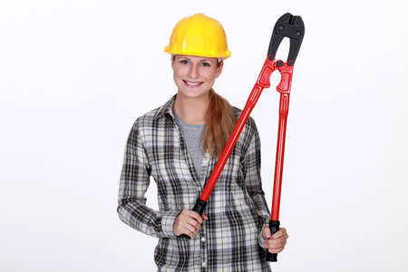 Woman holding large bolt-cutters photo