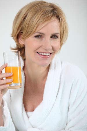30 to 40: Woman with orange juice