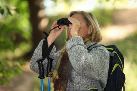 senior woman on a mountain hike photo