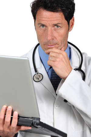 50 to 55 years: Doctor thinking Stock Photo