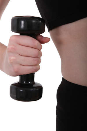 forceful: close-up of a hand taking a dumbbell Stock Photo