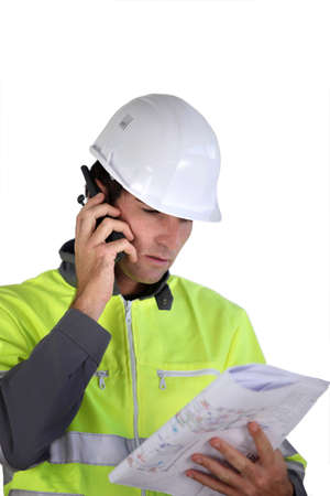 Worker with a two-way radio Stock Photo - 15573288