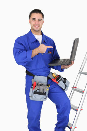 Electrician pointing at his computer Stock Photo - 15573245