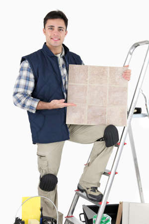Professional tile fitter posing with his building materials and tools Stock Photo - 15573301