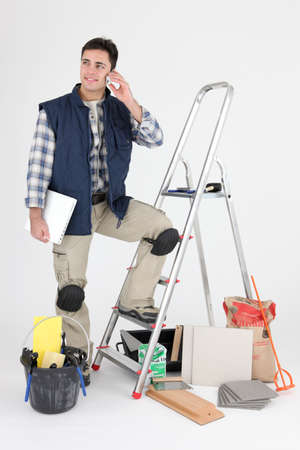 Tiler with his equipment Stock Photo - 15573802