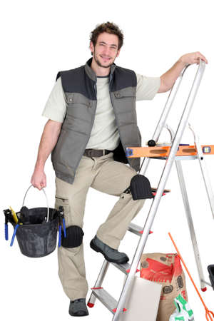 A tile fitter posing with his tools Stock Photo - 15573362