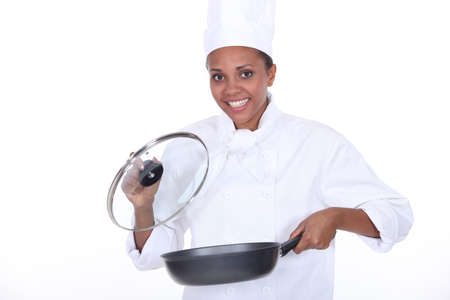 female chef: female chef exhibits a frying pan