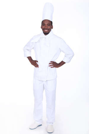laid back: Proud chef stood with hands on hips Stock Photo