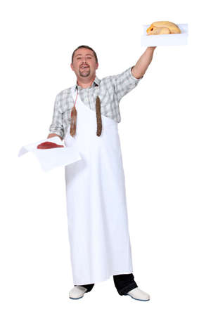 prime adult: Butcher holding chicken and beef