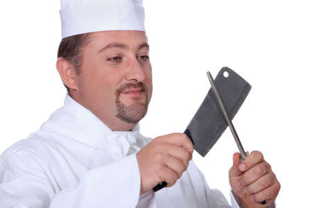 prudent: Chef sharpening a knife Stock Photo