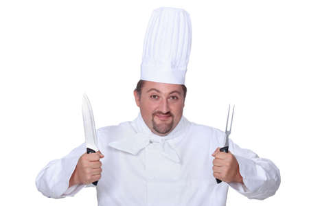 holding a knife: Chef holding knife and fork
