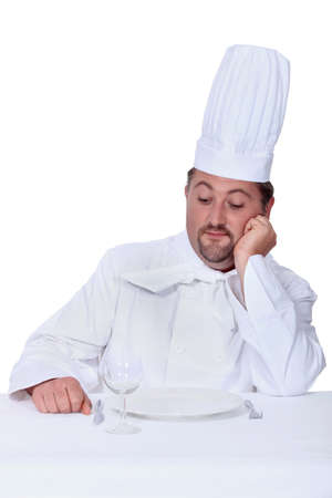 hefty: Chef looking disdainfully at an empty plate Stock Photo