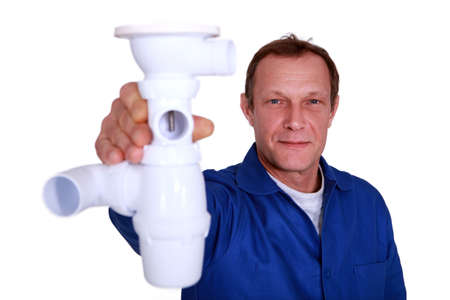 stood: Plumber holding replacement part
