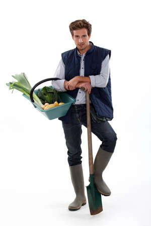 Man with basket of vegetables and shovel photo
